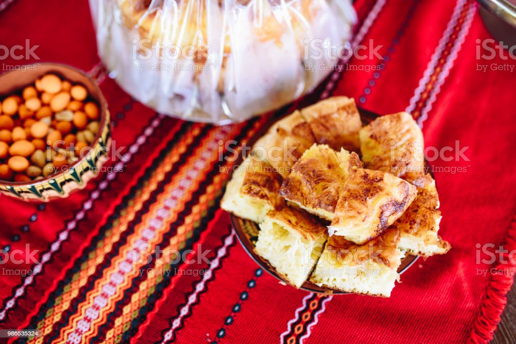 Traditional Bulgarian dish - Banitsa, on a traditional red background stock photo