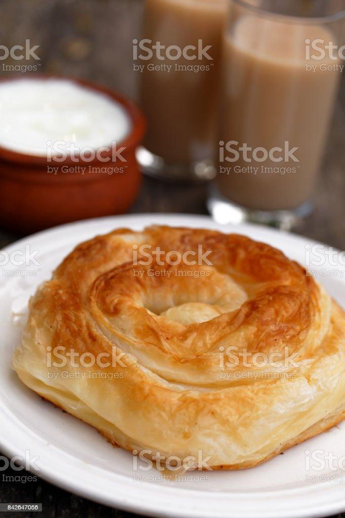 Traditional Bulgarian pastry Banitsa and beverage boza stock photo