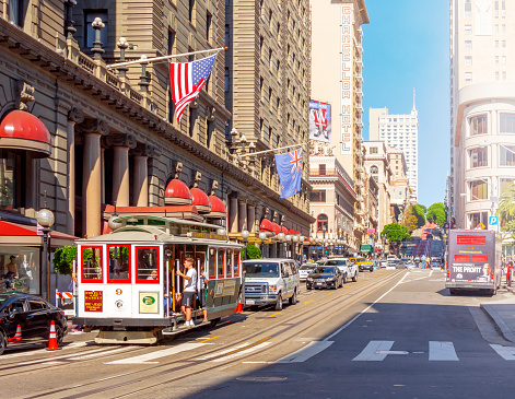 istock traditional Cable Car loaded with tourists moves in city traffic near Union Square in San Francisco 1149851484