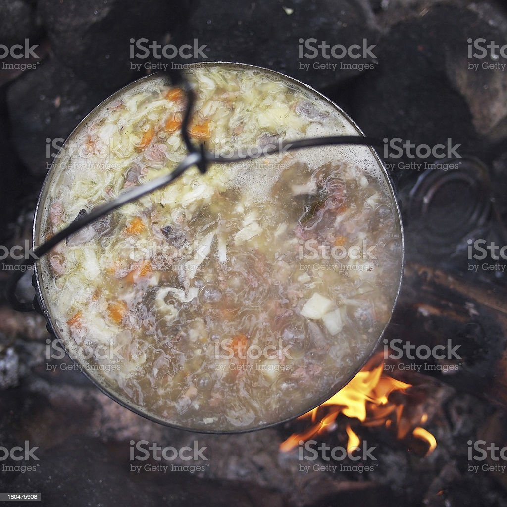 Traditional campfire cooking royalty-free stock photo