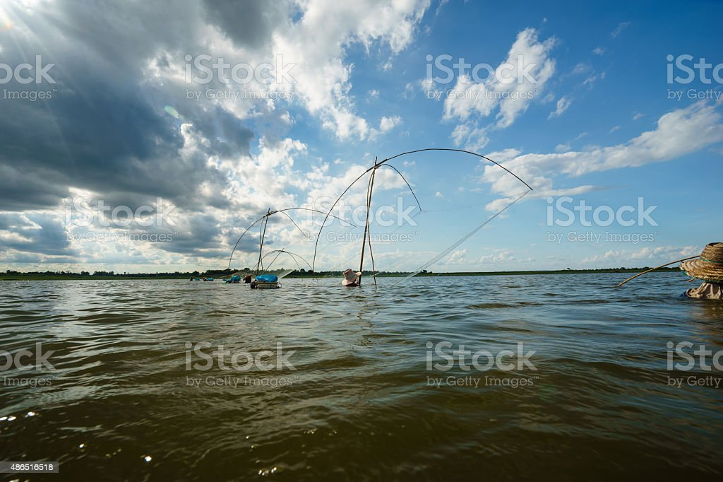 Traditional Catching fish with a net stock photo
