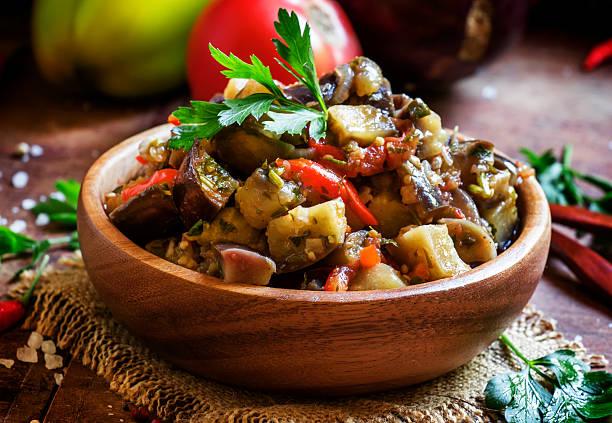 traditional caucasian saute from stewed eggplants - melanzane foto e immagini stock