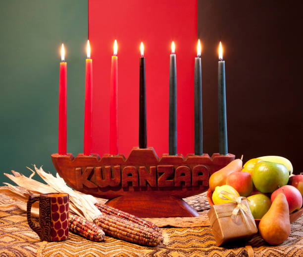 traditional celebration of kwanzaa with corns and fruits - kwanzaa stock pictures, royalty-free photos & images