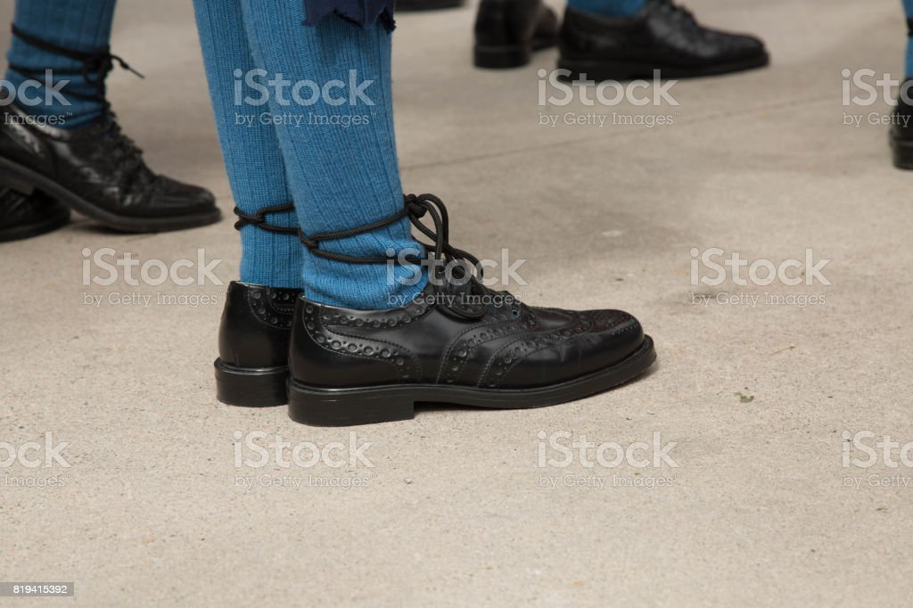 Traditional celtic stockings black shoes closeup stock photo
