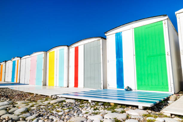 Traditional changing rooms on the beach Traditional changing rooms on the beach manche stock pictures, royalty-free photos & images