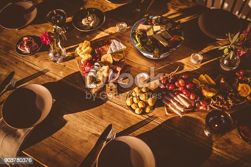 istock Traditional cheese and fruit platter with mediterranean salad and dips 903780376