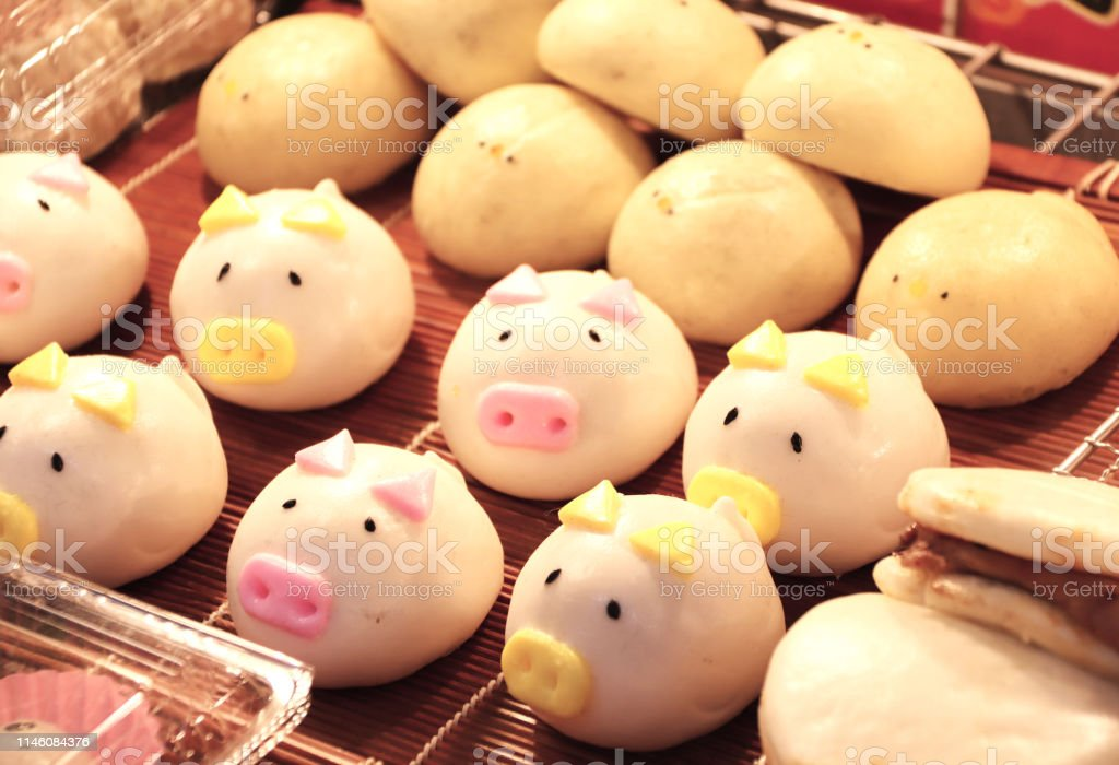 Traditional Chinese animal-shaped mantou buns Street food - traditional Chinese animal-shaped mantou buns - pigs and chicken, street market in Chinatown, Kobe, Japan Asia Stock Photo