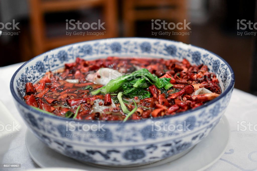Traditional Chinese chilli peppers sauce with beef. Spicy hot pot. stock photo