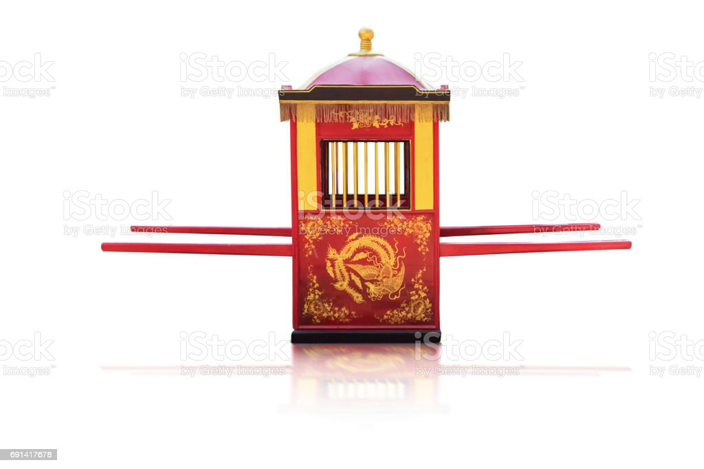 Traditional Chinese culture,Palanquin carrying the bride isolated on white background with clipping path. stock photo