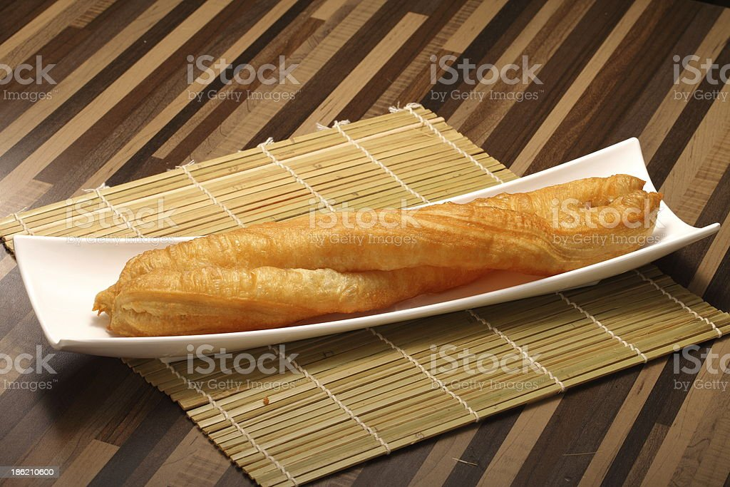 Traditional chinese deep fried bread stick on the dish royalty-free stock photo