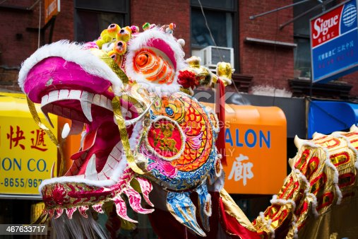 New York, United States - February 2, 2014: Traditional Chinese Dragon parades at the Lunar New Year Festival in Chinatown. Chinese dragons are legendary creatures in Chinese mythology and Chinese folklore.