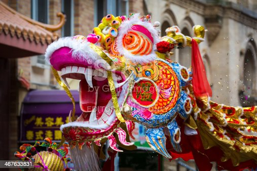 New Year, United States - February 2, 2014: Traditional Chinese Dragon parades at the Lunar New Year Festival in Chinatown. Chinese dragons are legendary creatures in Chinese mythology and Chinese folklore.