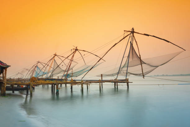 Traditional chinese fishing nets in Kochi, India at sunrise stock photo