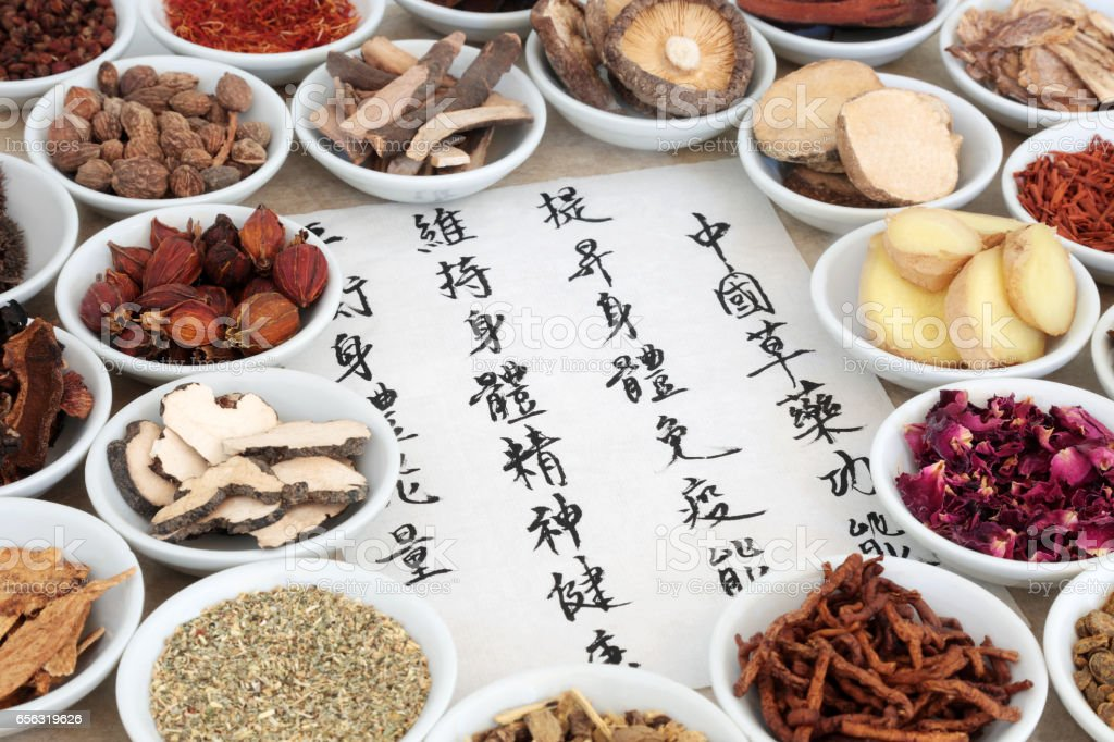 Chinese herb selection used in herbal medicine with calligraphy...