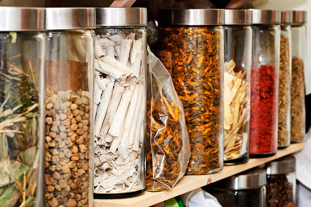 Traditional Chinese herbal medicines Traditional chinese medicine herbs and remedies in jars chinese herbal medicine stock pictures, royalty-free photos & images