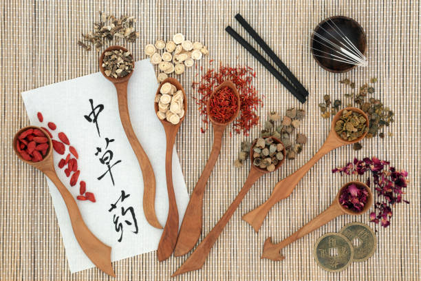 "Traditional Chinese Herbs Traditional chinese herbs, acupuncture needles, moxa sticks used moxibustion therapy, feng shui coins and calligrapgy script on rice paper on bamboo. Translation reads as chinese herbs. Top view.""n chinese herbal medicine stock pictures, royalty-free photos & images"