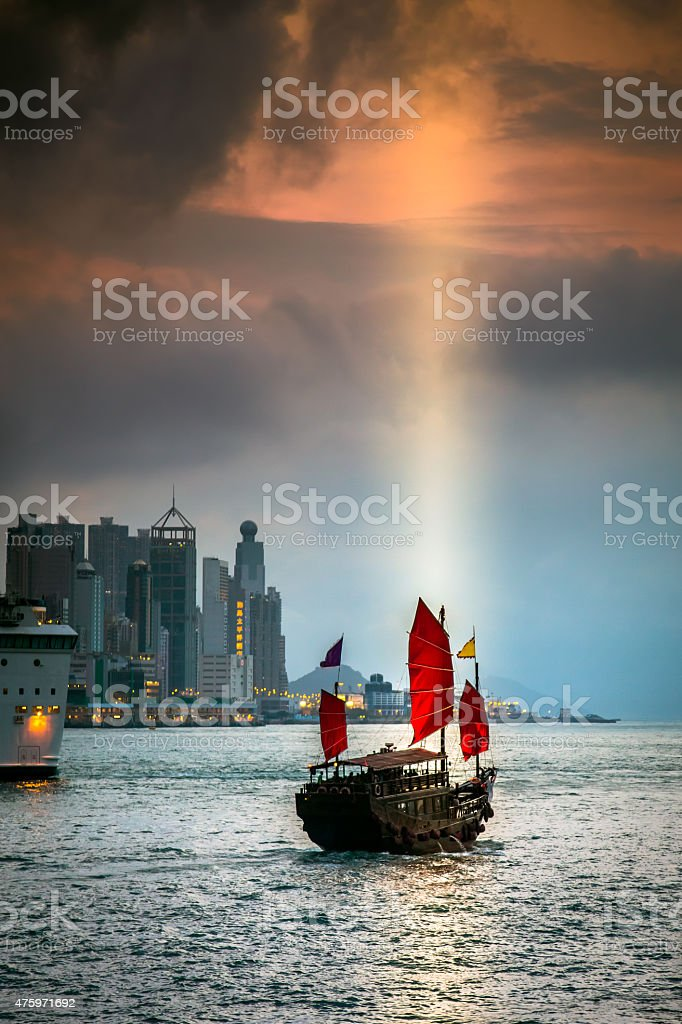 Traditional Chinese Junkboat Sailing Across Victoria Harbour, Hong Kong stock photo