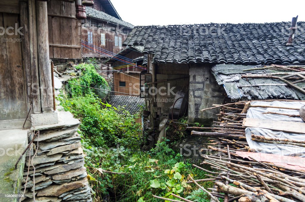 Traditional chinese minority village wooden houses on the mountainside stock photo