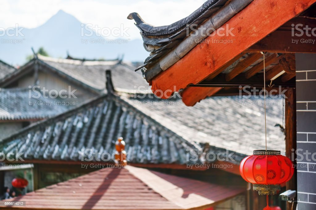 Traditional Chinese roof decorated with red lantern, Lijiang royalty-free stock photo