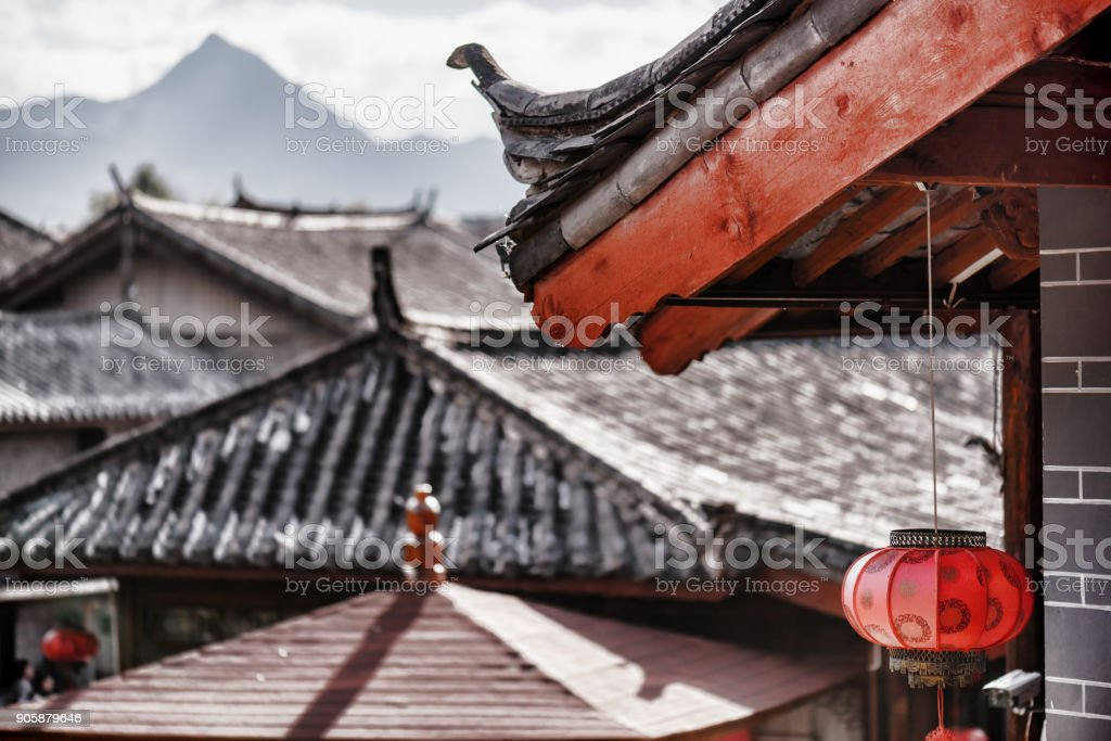 Traditional Chinese roof decorated with red lantern. Toned image stock photo