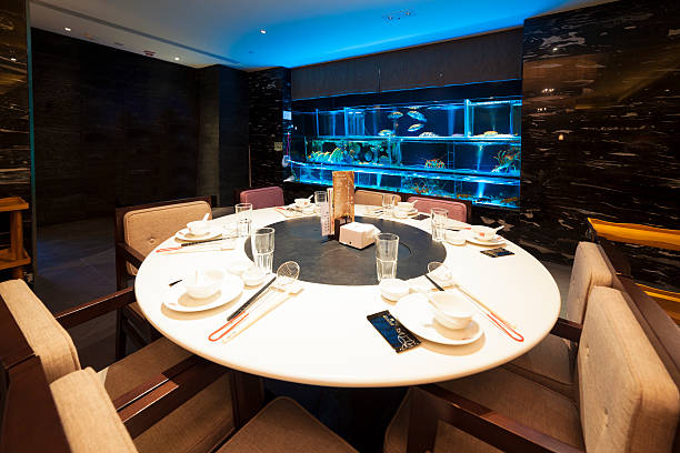 Traditional Chinese round hot pot table in restaurant​​​ foto