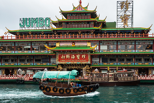 A Traditional Chinese Sampan Boat And Jumbo Floating Restaurant One Of The Most Famous Landmark Of Hong Kong Aberdeen Stock Photo - Download Image Now