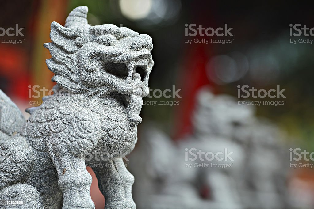 Traditional Chinese Stone lion sculpture in temple stock photo
