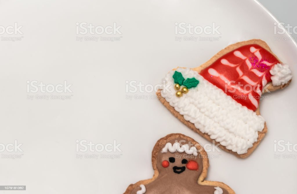 Traditional Christmas Cookies With Shapes Of A Funny Man And A Santa