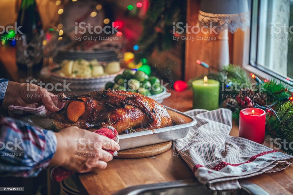 Traditional Christmas Duck Holiday Dinner with Oranges, Pomegranate,...