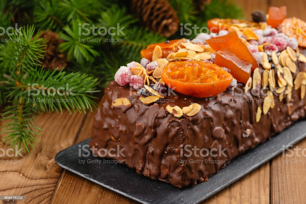 Traditional christmas fruit cake pudding in chocolate glaze stock photo