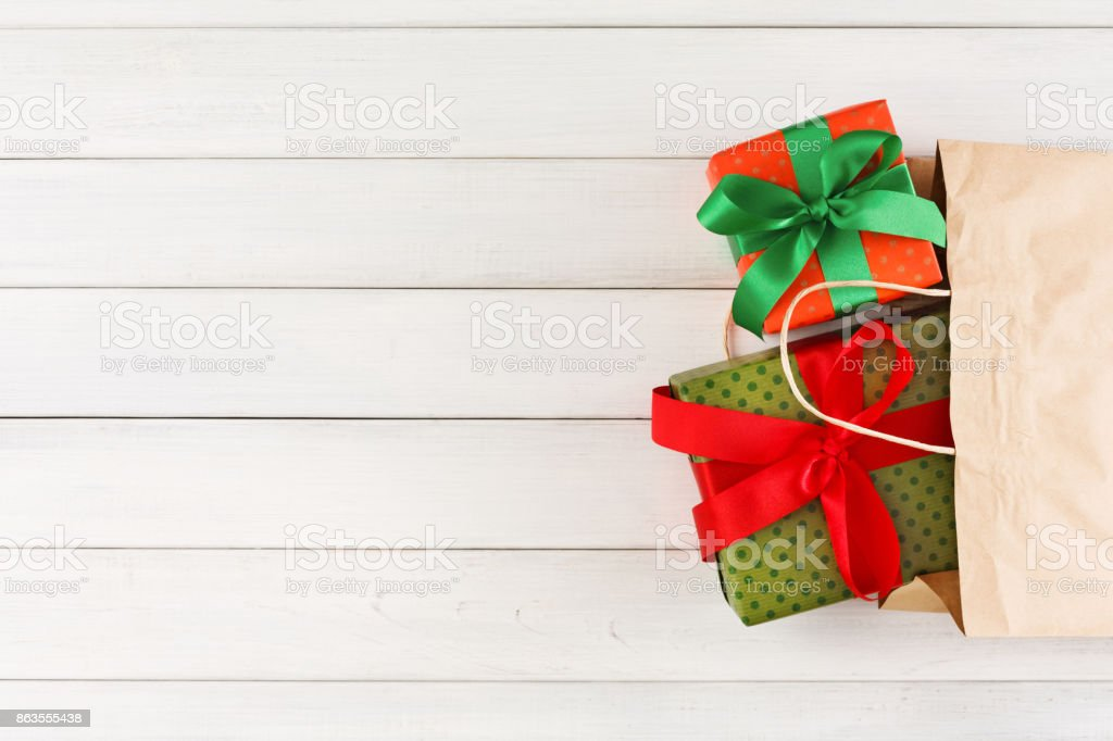 Traditional christmas gifts in paper bag on white rustic wood table background royalty-free stock & Traditional Christmas Gifts In Paper Bag On White Rustic Wood Table ...