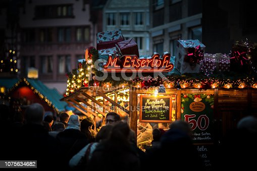 Frankfurt, Germany - December 1, 2018: The image shows a beautifully decorated Christmas Market Store in the old town of Frankfurt, Germany with shining light and happy people
