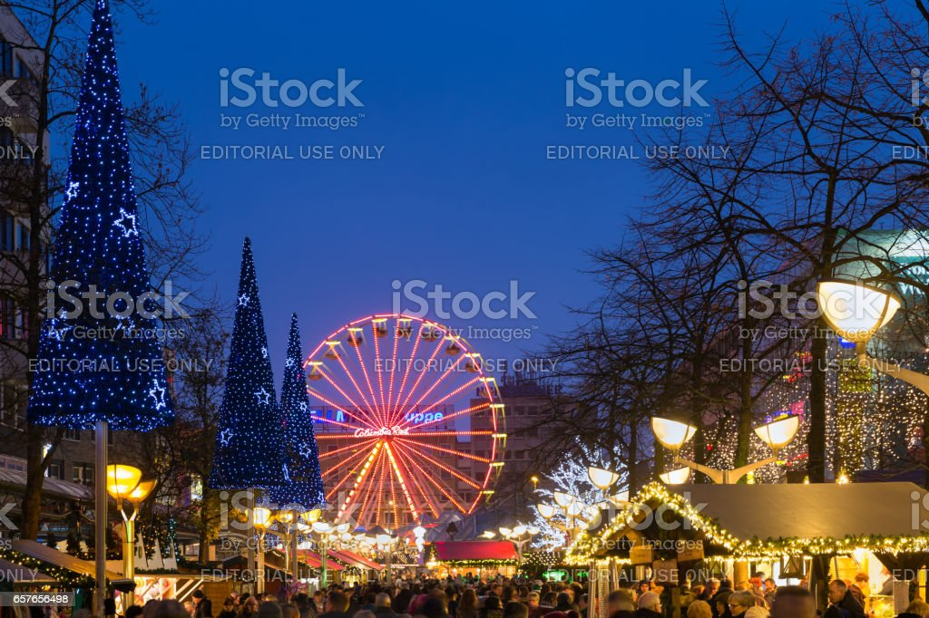 Traditional christmas market with illuminated ferris wheel in the center of Duisburg, Germany stock photo