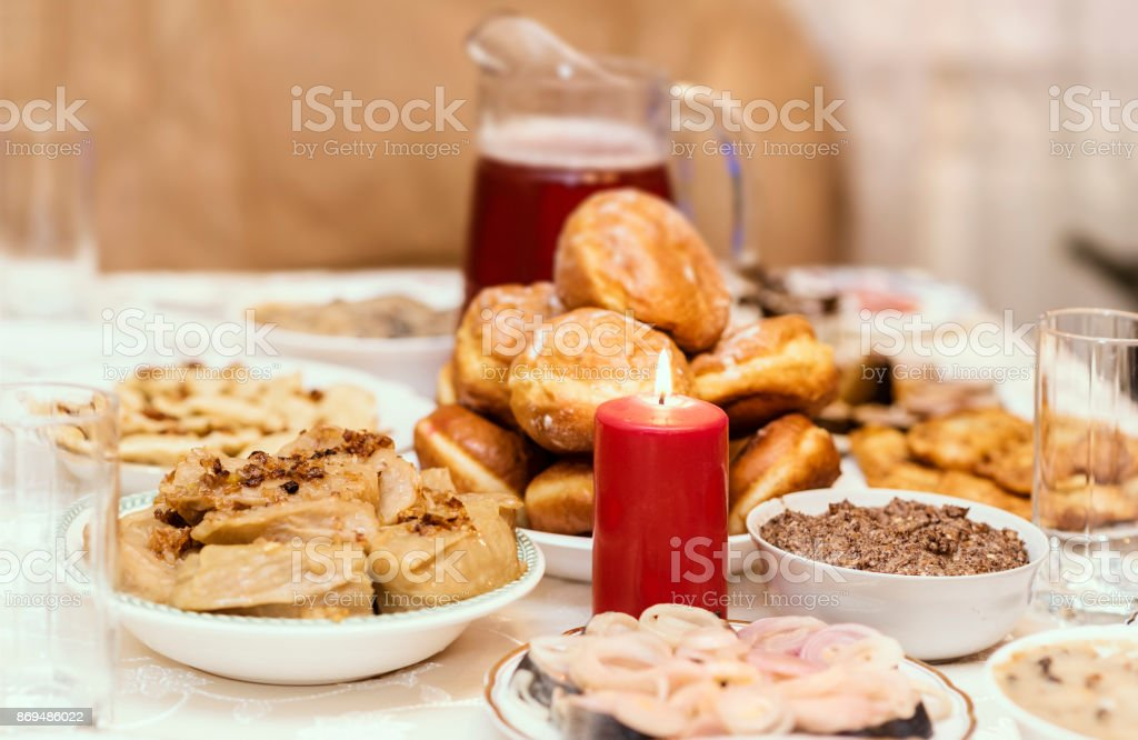 Traditional Christmas table in Ukraine, twelve meatless dishes: kutya, stewed fruit, beet soup, dumplings, mushroom picking, fried fish, herring, pickled mushrooms, beet salad, donuts, garlic stock photo