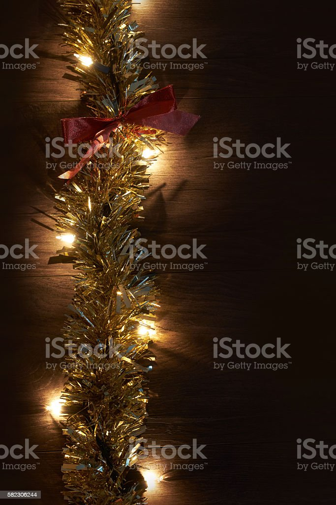 Traditional Christmas Lights.Traditional Christmas Tree Lights And Tinsel Lying On A Wooden Stock Photo More Pictures Of 25th Street