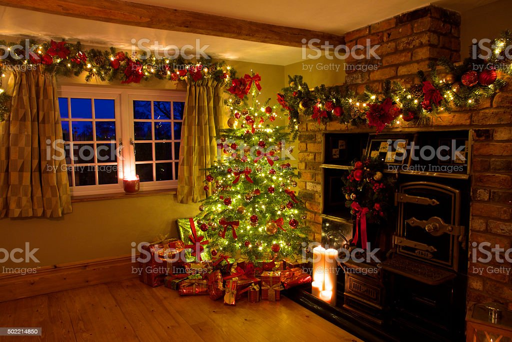 Traditional Christmas Tree with Presents in Warm Rustic Room Set - Royalty-free 2015 Stock Photo