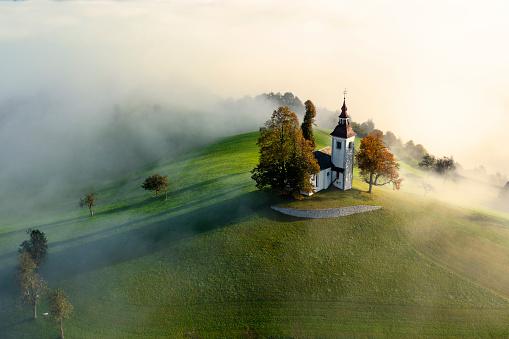 Traditional church between green hills.
