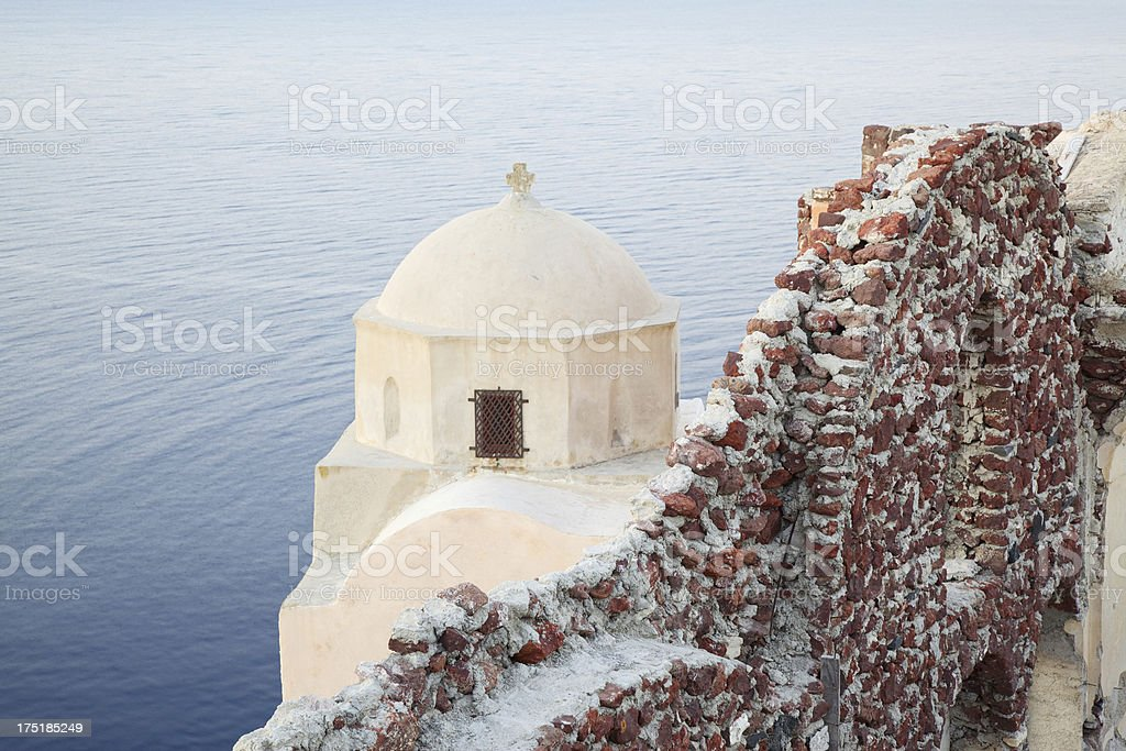 Traditional church in Oia village at sunset.  Santorini. Greece. royalty-free stock photo