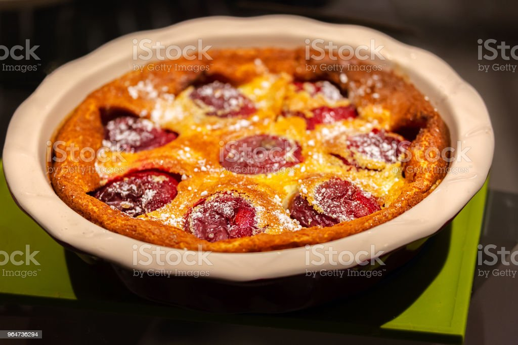 Traditional Clafoutis Pie with Plums royalty-free stock photo