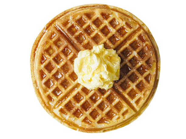 traditional classic belgium american waffle with butter and maple syrup close up of traditional classic belgium american waffle with butter and maple syrup waffle stock pictures, royalty-free photos & images