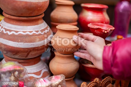 Handmade Traditional pottery mud jar for sale at market.
