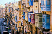 Traditional closed wooden balconies in Repubblika street, Valletta, Malta, Europe