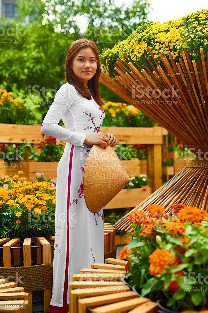 Traditional Clothing. Vietnam. Asian Girl In National Ao Dai Dress stock photo