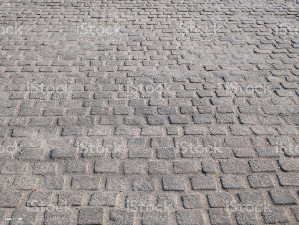 Traditional cobble stone street floor walk stock photo