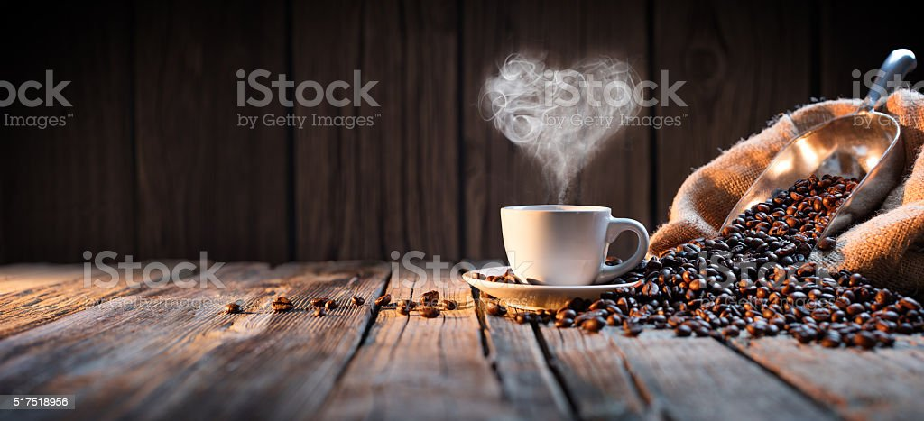 Traditional Coffee Cup With Heart-Shaped Steam On Rustic Wood stock photo