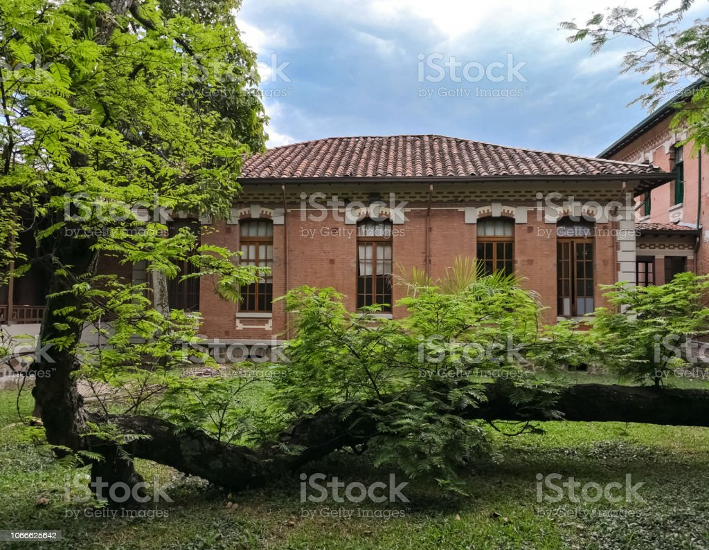 Traditional colonial house made of bricks and roof of clay tiles....
