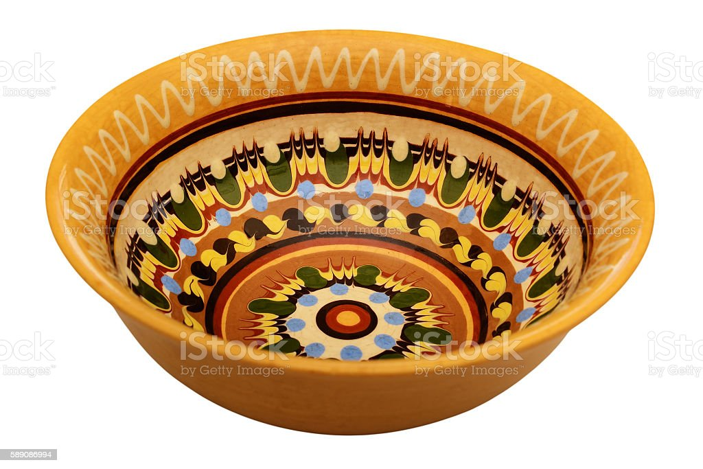 Traditional colored pottery. Painted ceramic plate. stock photo