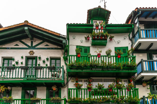 Traditional colorful fishermen houses in Hondarribia decorate with flowers, Basque Country, Gipuzkoa, Spain stock photo