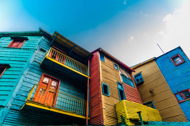 Traditional colorful houses on Caminito street in La Boca neighborhood, Buenos Aires Orange, red, blue, and yellow traditional South America houses Argentina stock pictures, royalty-free photos & images