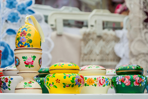 Traditional colorful pottery items, hand painted. Easter eggs for sale in local market of Budapest, Hungary.